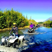 Cruising through water on an Alaska ATV tour