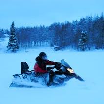Snowmobile adventures in Alaska's backcountry
