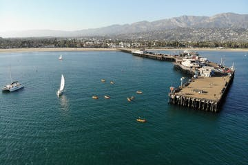 View of Santa Barbara pier and marina with people in the water