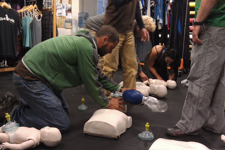 People training and practicing CPR