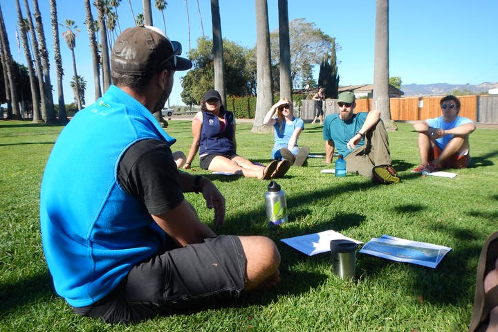 People training in the grass