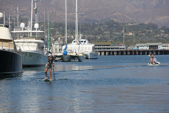 Man paddling near the marina