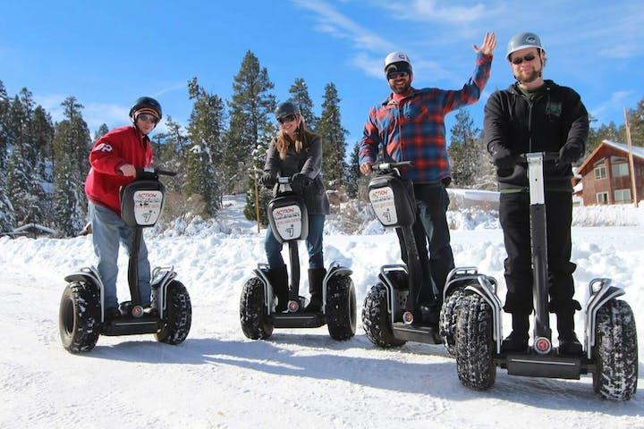 4 people on winter segways
