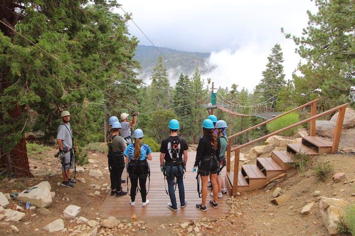 Group standing at top of zipline