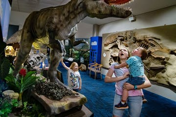 Group of children in a dinosaur museum