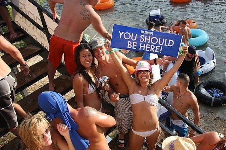A girl holding up a sign that says 'you should be here'