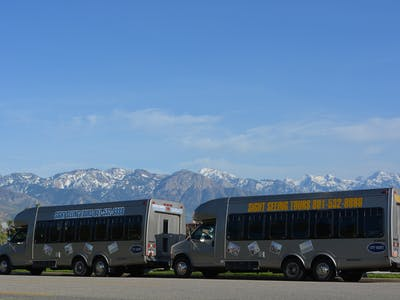 Two shuttle buses with mountains in background