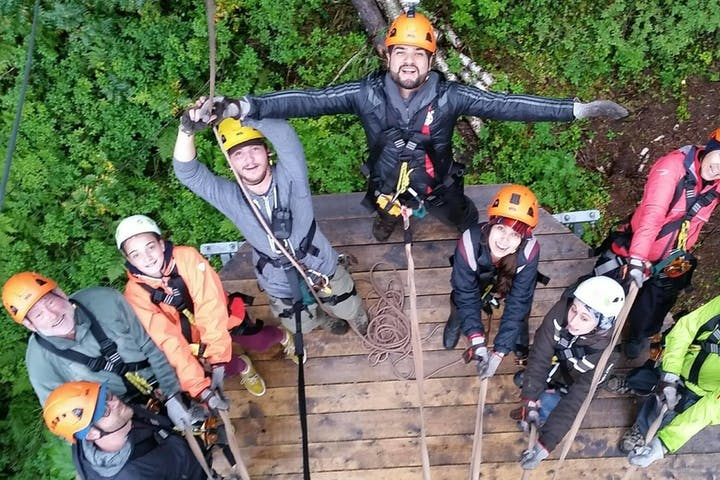 Zipline group smiling to camera