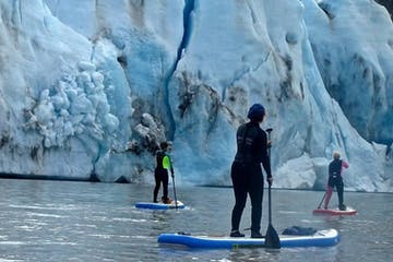 people stand up paddleboarding at Glacier Lake