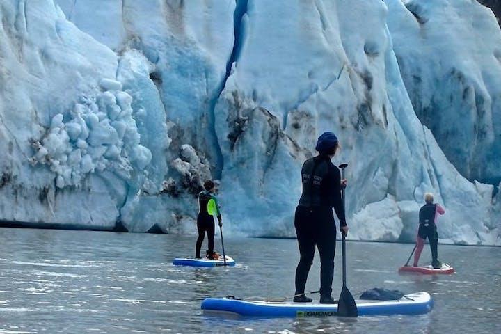 people stand up paddleboarding at Glacier Lake
