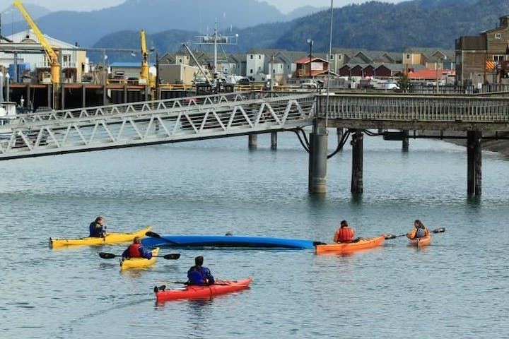 kayakers going under bridge in Homer