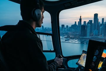 a helicopter pilot flying aircraft over a city