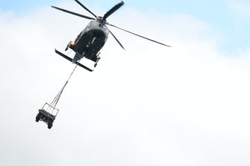Helicopter Carrying a Jeep