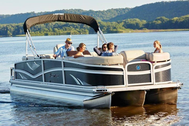 pontoon boat with passengers relaxing on the water