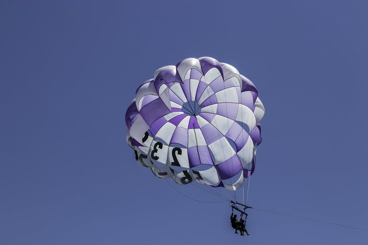happy visitors in a parasail