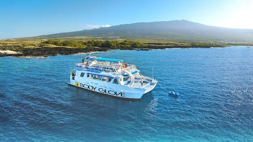 Body Glove catamaran in the waters of Big Island, Hawaii
