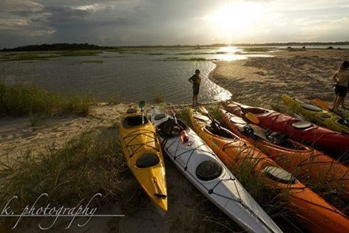 Kayaks parked along shore of Black River in Myrtle Beach, SC