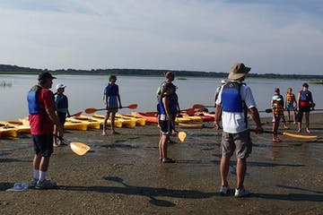 A group of kayakers prepares to embark on a tour in Myrtle Beach, SC