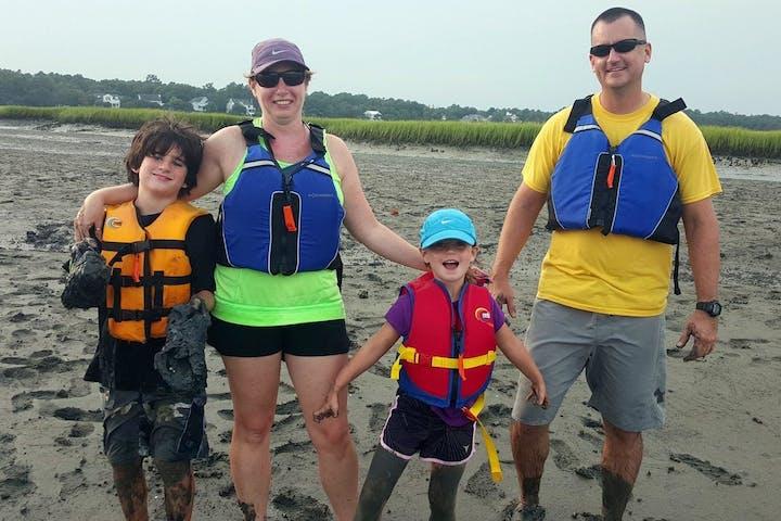 A family posing near a salt marsh in Myrtle Beach, SC