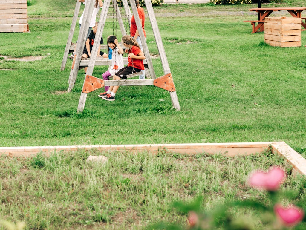 a swing set in a grassy field