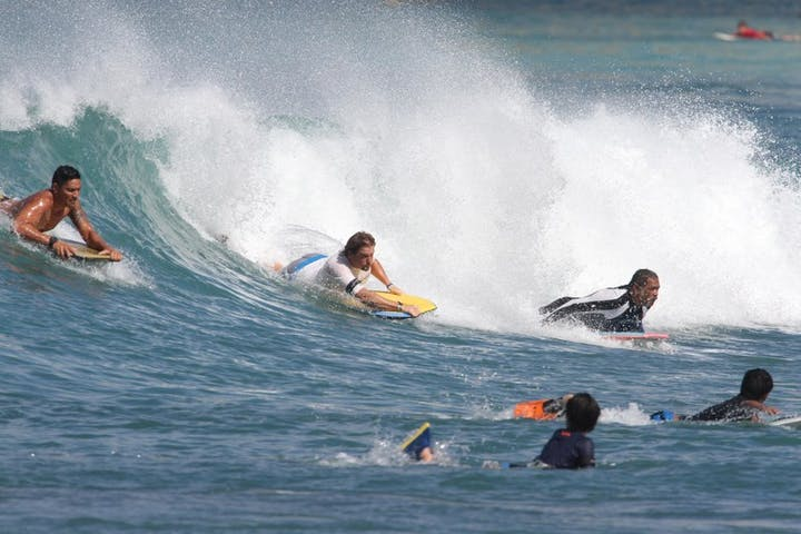 group body boarding on wave