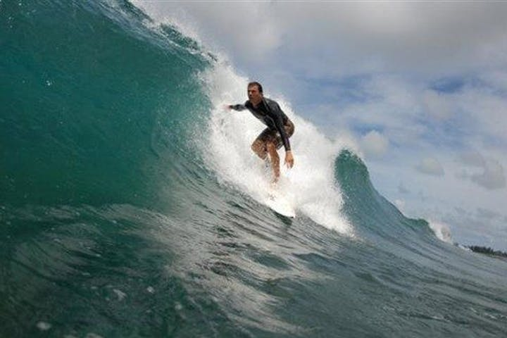 surfer on board riding wave