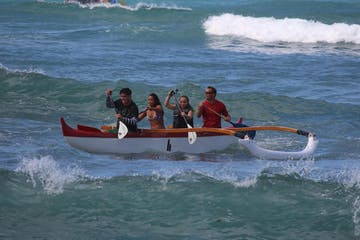 group in boat on water