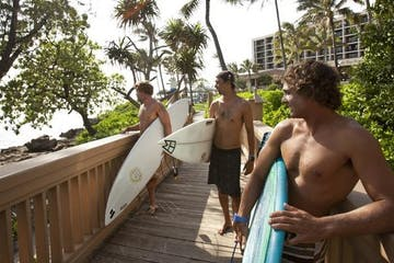group holding surf boards