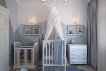 A kids room with a crib and a set of drawers