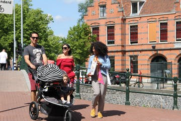 Debora is walking next to a couple with their pushchair
