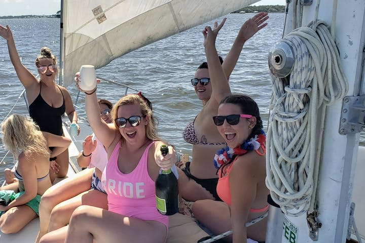 Group on sailboat with champagne