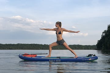 a person doing yoga on a paddleboard