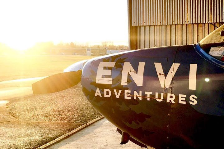 Envi Adventures airplane sitting in hangar during dusk