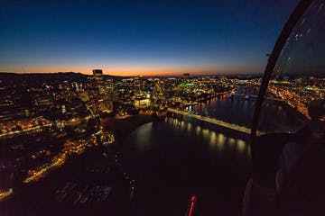 Flying over Portland at night with city lights