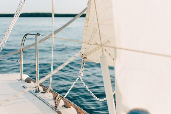 White boat sailing during daytime
