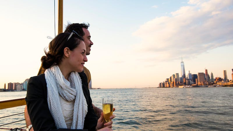Couple drinking wine and enjoying view of NYC