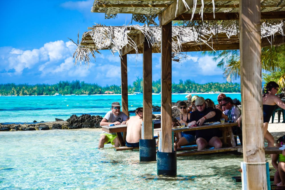 Enjoying your lunch with a perfect backdrop of paradise