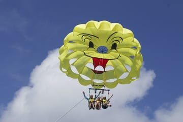 a parasailing flying in the air