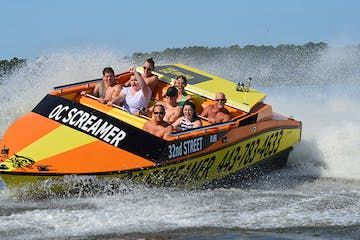 Group holds on tight as the jet boat rips around the bay