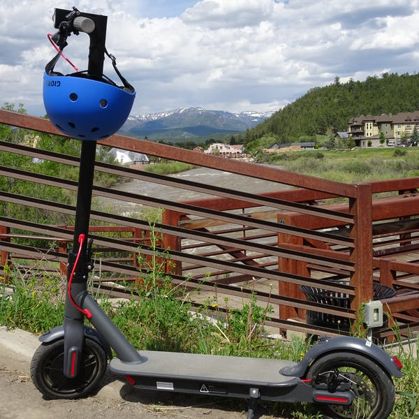 scenic view of mountains with scooter in foreground