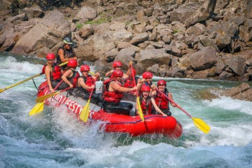 whitewater rafters going through rapids during half day trip