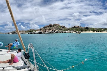 Panorama view of catamaran anchored in bright blue waters on the Caribbean