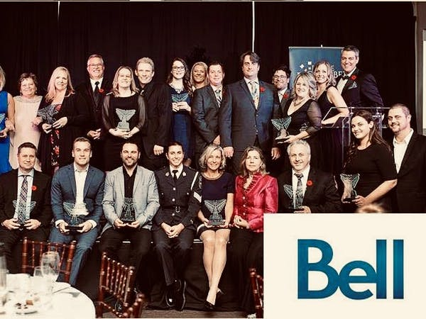 Group shot of business owners and their awards
