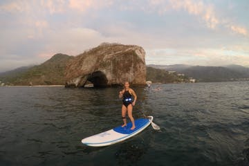 Woman Paddle boarding in the ocean