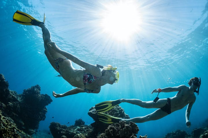 Man and Woman Freediving underwater