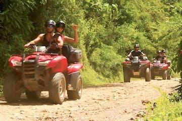 ATVs coming down a dirt road