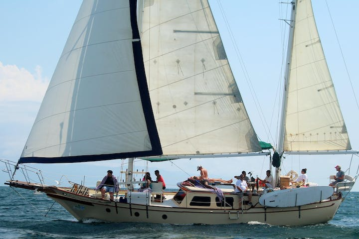 Large sailboat with group aboard