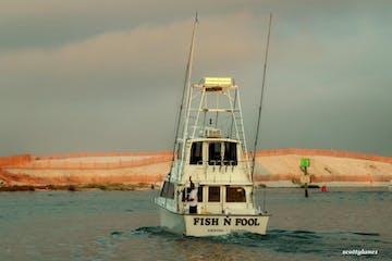 Fish N Fool boat heading toward shore