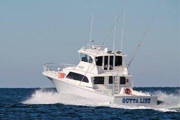 large charter cruising away