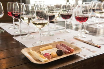 a wooden table topped with glasses of wine